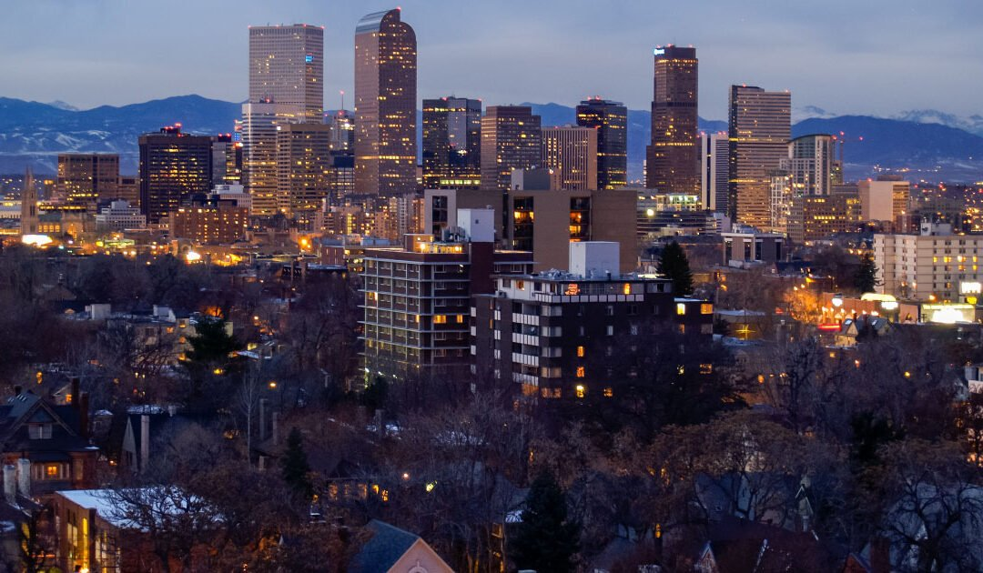 A nighttime, aerial view of the Denver skyline and some surrounding neighborhoods – Park hill is our latest neighborhood spotlight